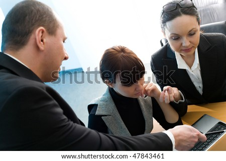 Men in suit with girl and women with notebook - stock photo