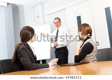 Men in tie with cup and girl with women - stock photo