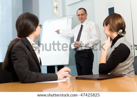 Men in tie with cup and nice girl with women - stock photo