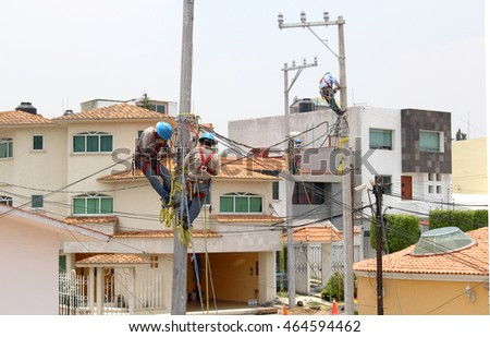 Men installing lampposts