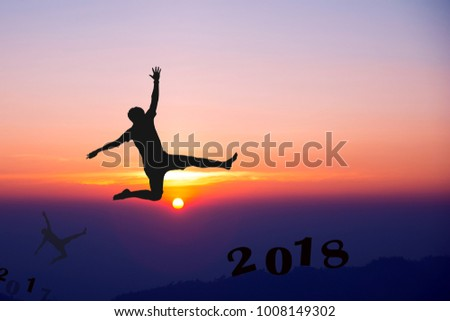 Men jump over silhouette on sunrise Happy New Year 2018.copy space.