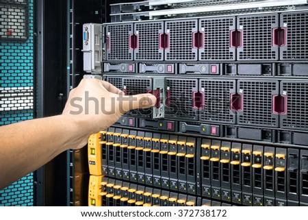 men maintenance cooling system of computer server - stock photo