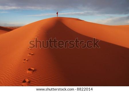 Men observed sand desert - stock photo