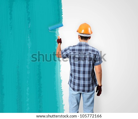 Men painting and paint brush house - stock photo