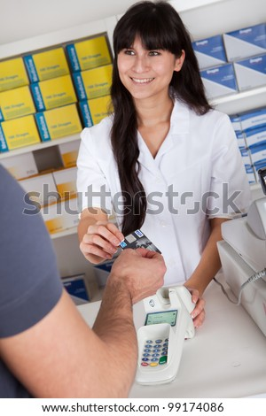 Men paying cash for medicine at the drugstore - stock photo