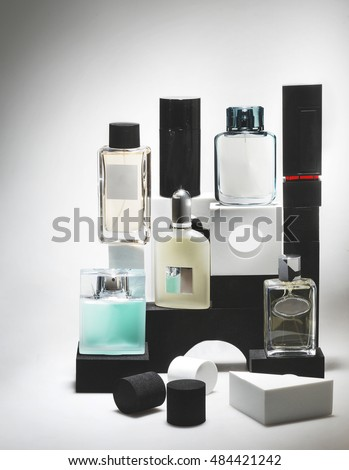 men perfume bottles on a composition with cubes and others shapes