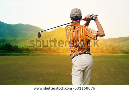 Men player golf hit swing shot on course in morning sunrise