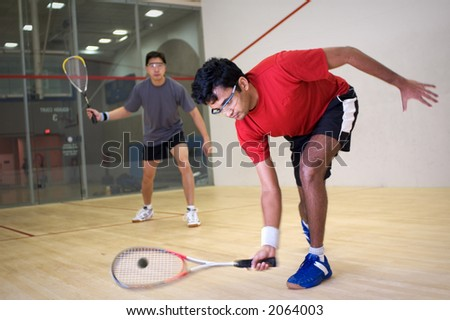 Men playing squash - stock photo
