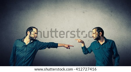 men pointing on each other