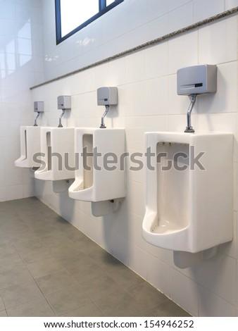 Men public toilet  - stock photo