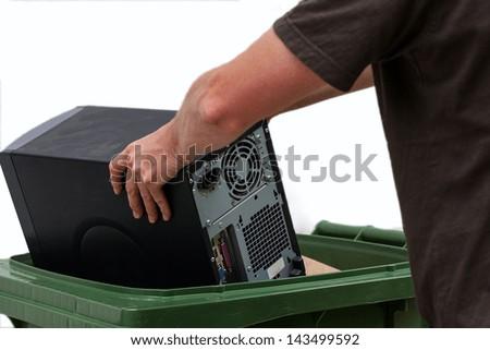 Men put damaged hardware into bin - stock photo