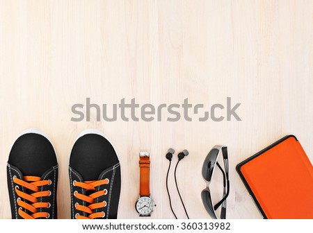 Men's accessories on a light wooden background.
