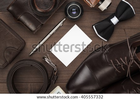 men's accessories on the brown wooden table - stock photo