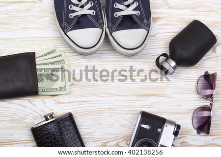 Men's accessories: wallet, flask, sunglasses,perfume, camera and sneakers. - stock photo
