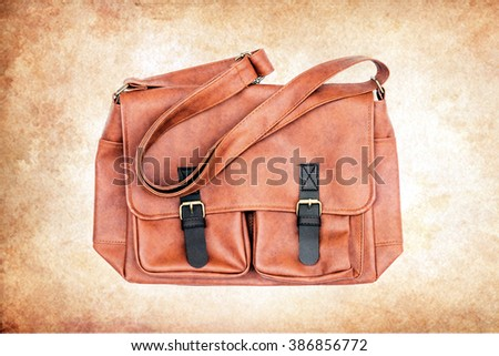 Men's accessories with brown leather bags on grunge background