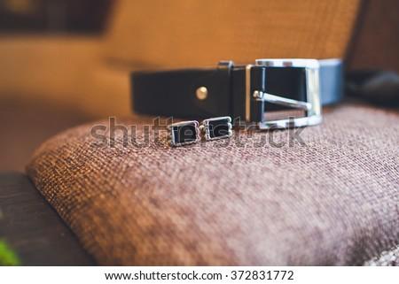 Men's belt and cufflinks - stock photo