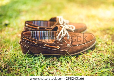 men's brown leather shoes, suede leather. men's fashion concept, brown moccasins ready for catalog and sale - stock photo