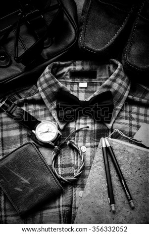 Men's casual outfits background, plaid shirt, bow tie, shoes, bag and accessories, black and white - stock photo