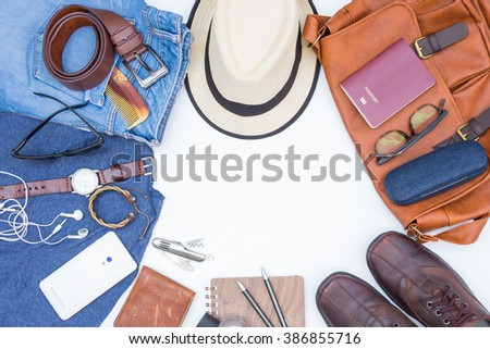 Men's casual outfits with accessories for travel during vacation  - stock photo