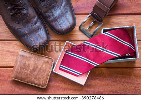 Men's casual outfits with accessories on wooden background - stock photo