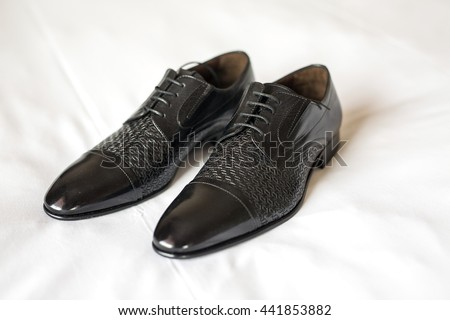 Men's Classic Black Leather Shoes on White Background - stock photo