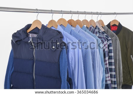 men's clothing on a hanger  - stock photo