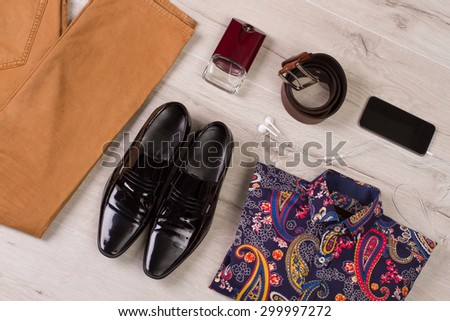 Men's collection on a wooden background. - stock photo
