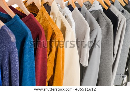 men's colorful clothes shirts , coat on hangers