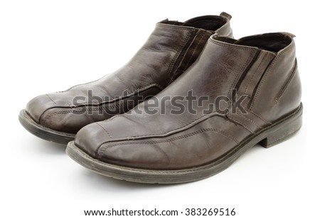Men's dark brown shoes isolated on white background.