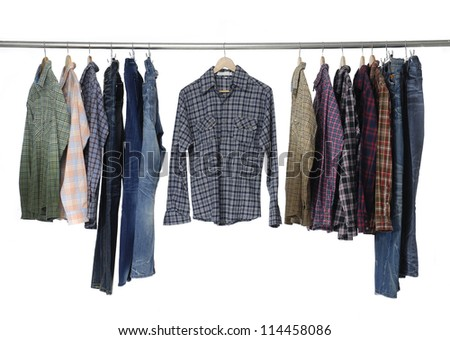 Men's different sleeved plaid cotton with jeans on a wooden hanger - stock photo