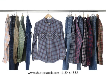 Men's different sleeved plaid cotton with jeans on hanger - stock photo