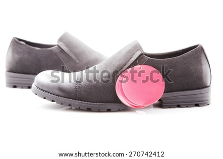 men's dress shoes with red price tag on a white background, close-up - stock photo
