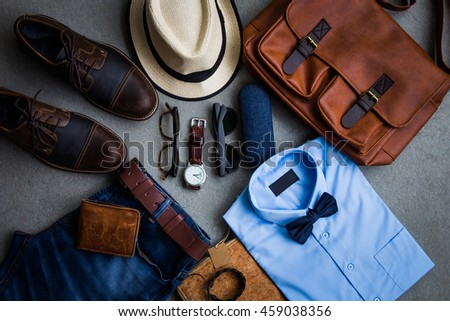 Men's fashion, casual outfits with accessories, flat lay, top view on gray grunge background