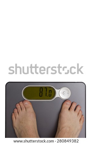 Men's feet on the floor scales. Weight control. - stock photo