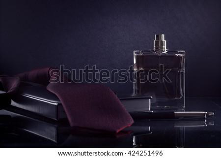 Men's fragrance on the desktop. - stock photo