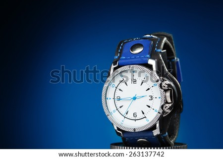 men's gold watches with wide leather bracelet  - stock photo