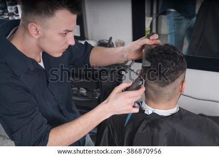 Men's haircut at the barber scissors