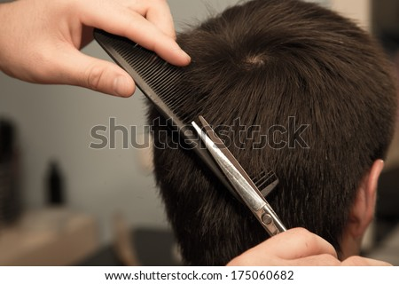 Men's haircut scissors at salon