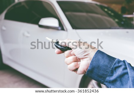 Men's hand presses on the remote control car key