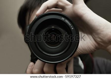 Men's hands held camera closeup - stock photo