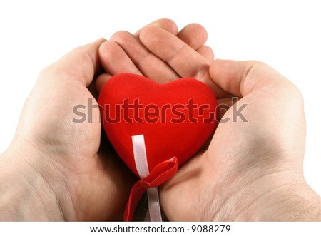 Men's hands holding a red heart in palms