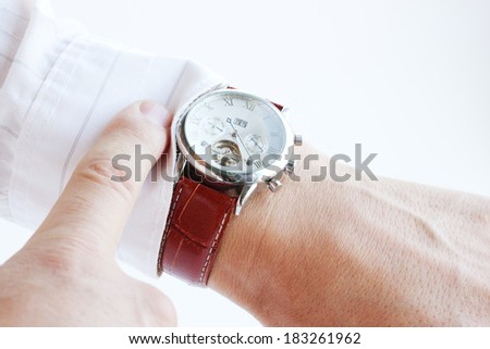 Men's hands, pointing the finger at the clock - stock photo