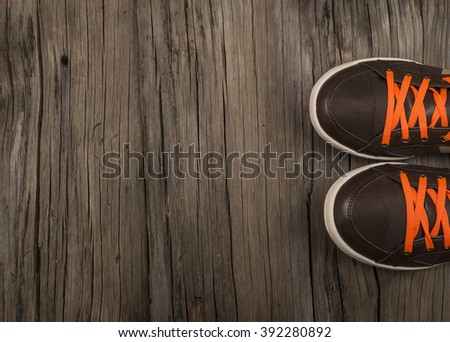 men's leather shoes top view close-up . brown sneakers on wooden floor view from above - stock photo
