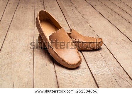Men's Loafer Shoe on old wood background