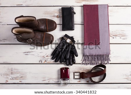 Men's shoes and set of accessories on a white wooden background. - stock photo
