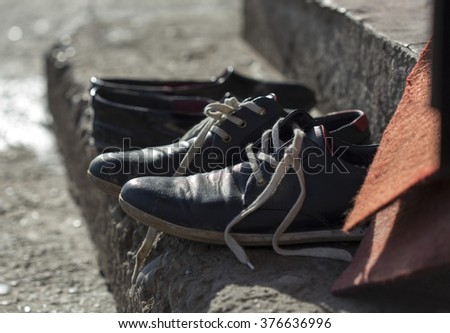 men's shoes in the street - stock photo