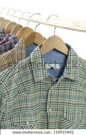 Men's sleeved plaid cotton on a wooden hangers - stock photo