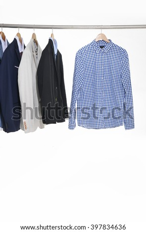 men's suits hanging on the white background - stock photo