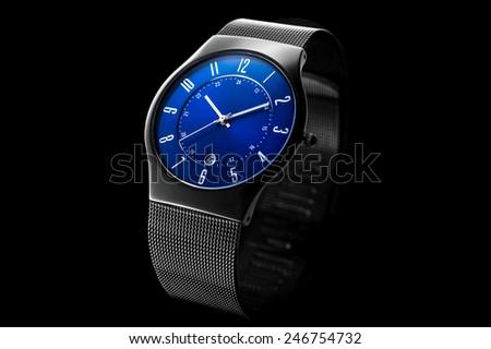 Men's wristwatch isolated on black background - stock photo