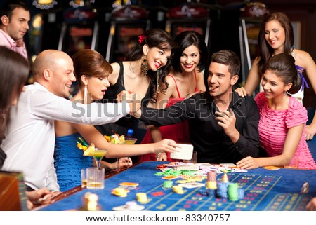 men shaking hands and celebrating winning game - stock photo